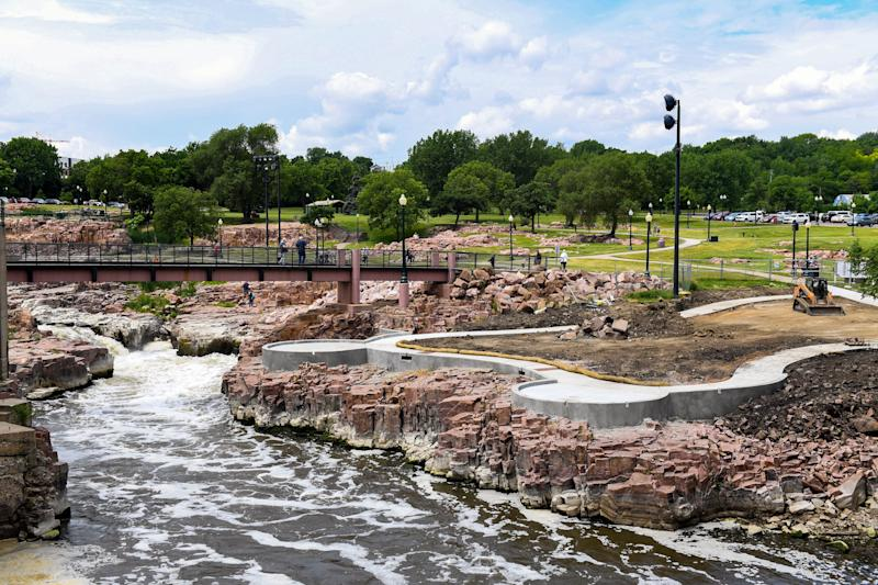 Construction is underway on new concrete lookout platforms Wednesday, June 19, at Falls Park in Sioux Falls.