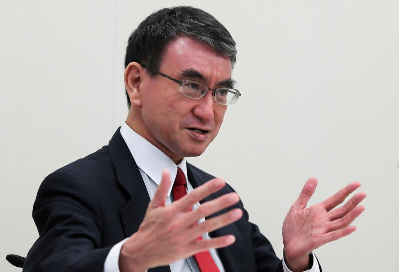 Japan's Vaccine Minister Taro Kono, who is running to replace Prime Minister Yoshihide Suga, speaks during a group interview in Tokyo