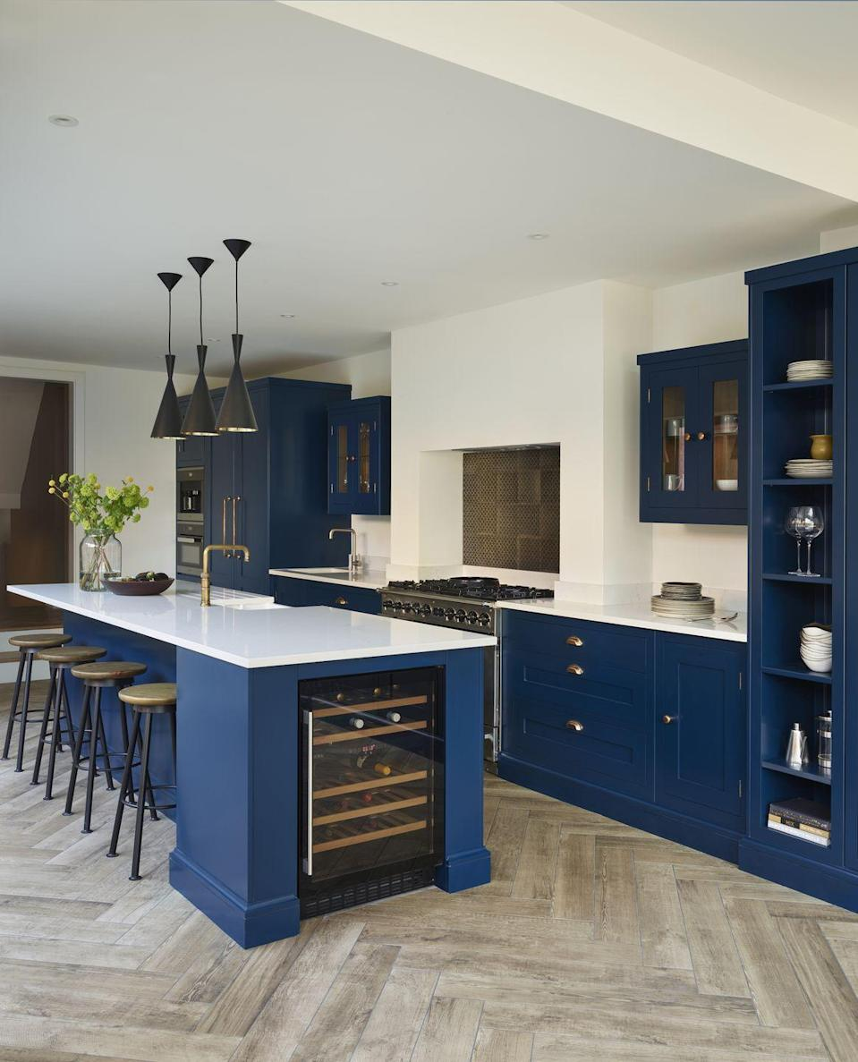"""<p>Size is vital when planning your kitchen island scheme — especially if you're a little tight on space. It sounds obvious but make sure you can move around the island with ease. If you're incorporating seating, it could be worth leaving extra room behind the chairs.</p><p>• 'Cusack' blue shaker style kitchen from <a href=""""https://www.harveyjones.com/our-kitchens/shaker-kitchens/industrial-inspired-family-space"""" rel=""""nofollow noopener"""" target=""""_blank"""" data-ylk=""""slk:Harvey Jones"""" class=""""link rapid-noclick-resp"""">Harvey Jones</a>. Blue paint in Little Greene's <a href=""""https://www.littlegreene.com/royal"""" rel=""""nofollow noopener"""" target=""""_blank"""" data-ylk=""""slk:Royal Navy 257"""" class=""""link rapid-noclick-resp"""">Royal Navy 257</a>. </p>"""