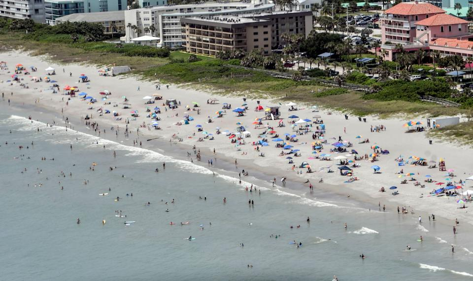 Beachgoers enjoy the sun and sand eat Shepard Park in Cocoa Beach Saturday afternoon, June 27, 2020. Mandatory Credit: Craig Bailey/FLORIDA TODAY via USA TODAY NETWORK