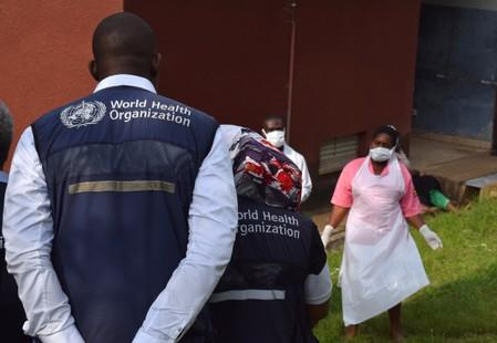 World Health Organization (WHO) officials talk to Ugandan medical staff as they inspect ebola preparedness facilities at the Bwera general hospital near the border with the Democratic Republic of Congo in Bwera