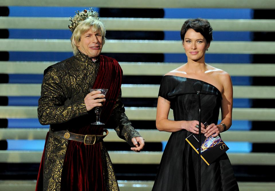 Andy Samberg, left, and Lena Headey present the award for outstanding miniseries on stage at the 66th Primetime Emmy Awards at the Nokia Theatre L.A. Live on Monday, Aug. 25, 2014, in Los Angeles. (Photo by Vince Bucci/Invision for the Television Academy/AP Images)