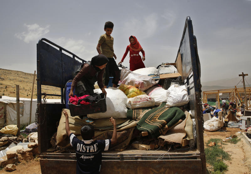 A Syrian family loads their belongings on a pickup, as they evacuate an informal refugee camp after a fight broke out last week between camp residents and Lebanese firefighters who arrived to put out a fire, in Deir Al-Ahmar, east Lebanon, Sunday, June 9, 2019. Dozens of Syrian refugees have dismantled their tents in a camp they lived in for years in eastern Lebanon after authorities ordered their evacuation following a brawl with locals. Lebanon hosts over 1 million Syrian refugees who fled the war next door since 2011, overwhelming the country of nearly 5 million. (AP Photo/Hussein Malla)