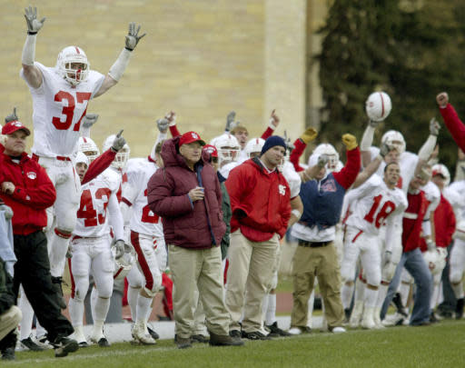 FILE - In this Nov. 1, 2003, file photo, the St. Johns bench celebrates the winning field goal for a 15-12 victory over Div. III NCAA football rival St. Thomas, in St. Paul Minn. St. John's and St. Thomas will stage their final game as Minnesota Intercollegiate Athletic Conference foes at U.S. Bank Stadium this fall. The 90th edition in the series will be played Nov. 7, 2020. (AP Photo/Andy King, File)
