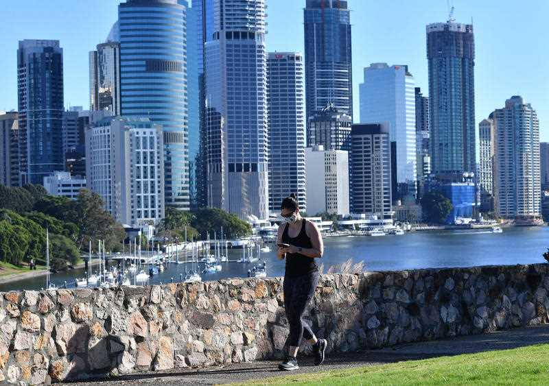 A woman is seen exercising at Kangaroo Point in Brisbane.