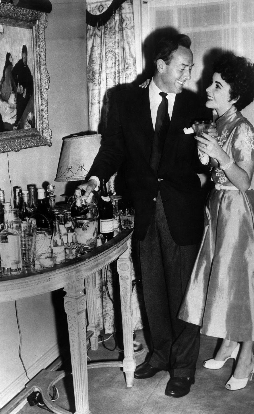 <p>Elizabeth wed beau Michael Wilding in February 1952. The two British-born actors had a low-key ceremony at Caxton Hall in London. </p>