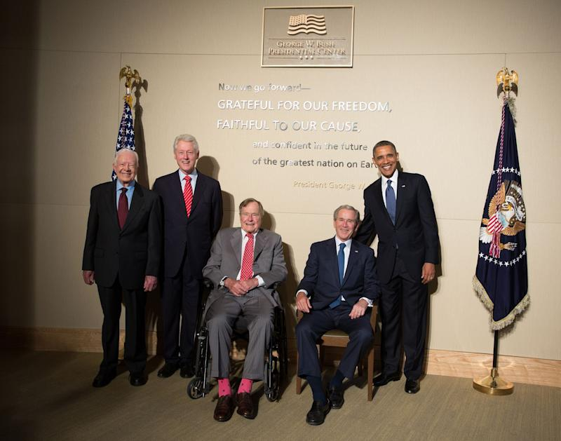 In this handout photo taken on April 25, 2013, and released by George W. Bush Presidential Center, former U.S. Presidents from left, Jimmy Carter, Bill Clinton, George H. W. Bush, George W. Bush pose with President Barack Obama for a group photo at the George W. Bush Library in Dallas, Texas.