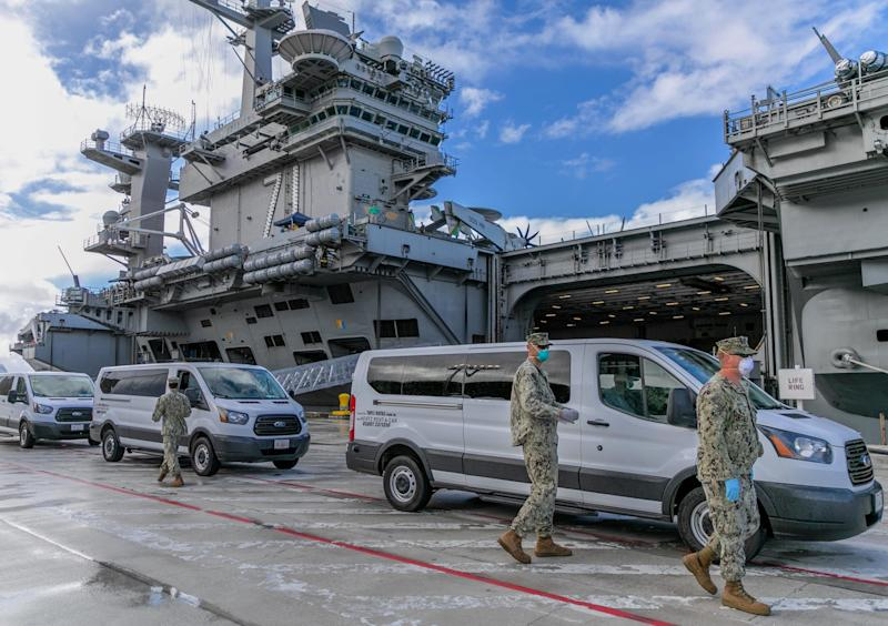 Seabees coordinate transportation of Sailors assigned to the aircraft carrier USS Theodore Roosevelt