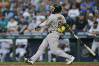 Oakland Athletics' Jed Lowrie watches his two-run single during the third inning of the team's baseball game against the Seattle Mariners, Saturday, July 24, 2021, in Seattle. (AP Photo/Ted S. Warren)