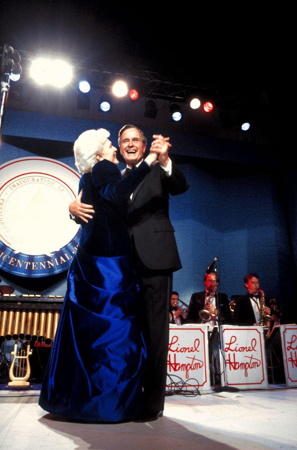 <p>President Bush shares his first dance with his wife, Barbara Bush, at his inaugural ball in 1989. Bush defeated Democratic candidate Michael Dukakis in the election and went on to serve one term as President. </p>