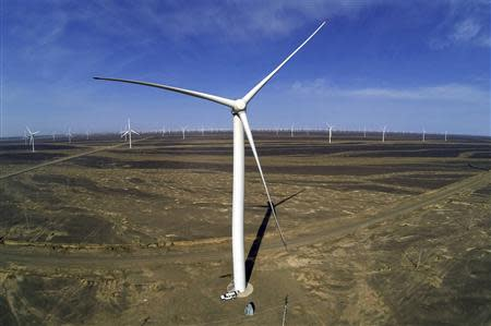 Wind turbines for generating electricity are seen at a wind farm in Guazhou, 950km (590 miles) northwest of Lanzhou, Gansu Province September 15, 2013. REUTERS/Carlos Barria