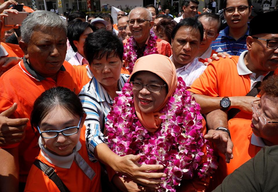 Singapore's President-elect Halimah Yacob greets supporters as she leaves the nomination centre in Singapore September 13, 2017. REUTERS/Edgar Su