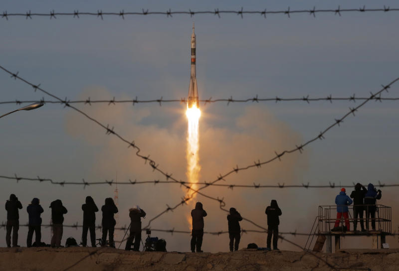 The Soyuz-FG rocket booster with Soyuz MS-11 space ship carrying a new crew to the International Space Station, ISS, blasts off at the Russian leased Baikonur cosmodrome, Kazakhstan, Monday, Dec. 3, 2018. The Russian rocket carries U.S. astronaut Anne McClain, Russian cosmonaut Oleg Kononenko‎ and CSA astronaut David Saint Jacques. (AP Photo/Dmitri Lovetsky)