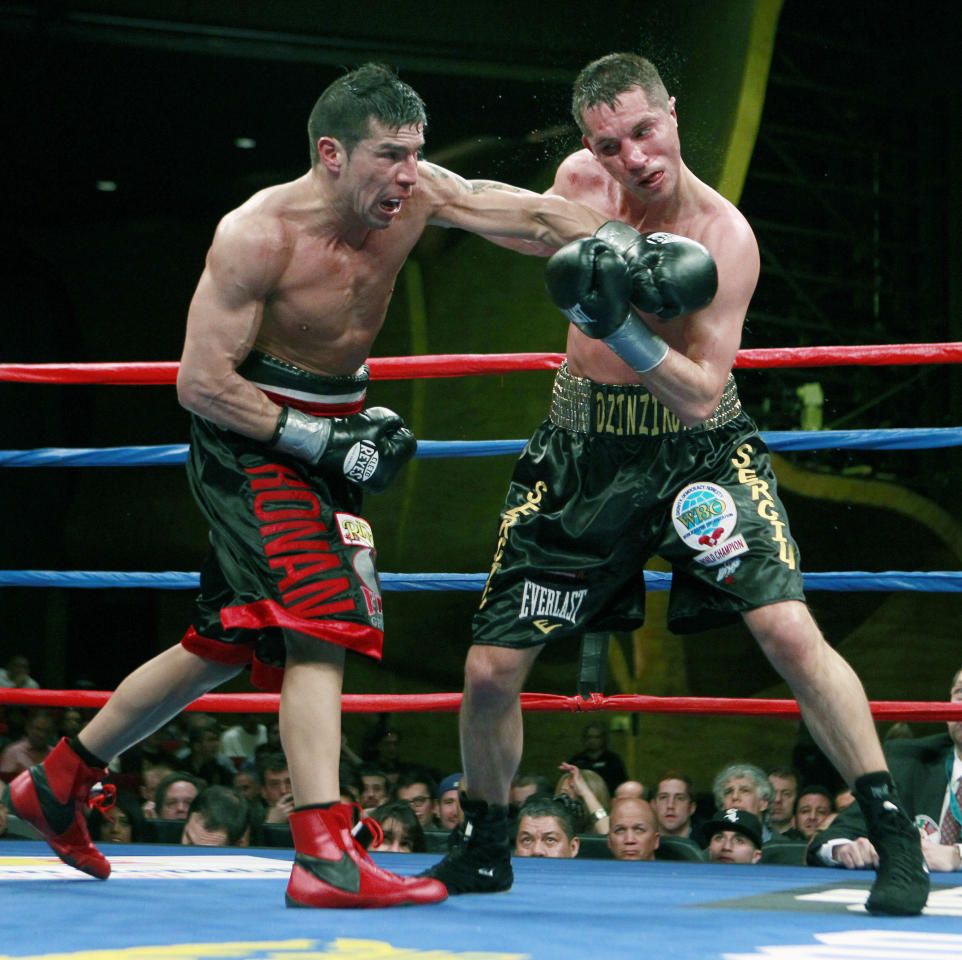 Sergio Martinez, left, lands a punch on Sergiy Dzinziruk, of Germany, in the eighth round of their WBC middleweight title boxing match in Mashantucket, Conn., Saturday, March 12, 2011. Martinez won in the eight round on a TKO.