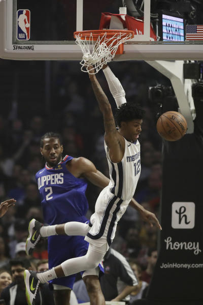 Memphis Grizzlies' Ja Morant (12) misses on a dunk attempt as Los Angeles Clippers' Kawhi Leonard (2) defends during the first half of an NBA basketball game Saturday, Jan. 4, 2020, in Los Angeles. (AP Photo/Marcio Jose Sanchez)
