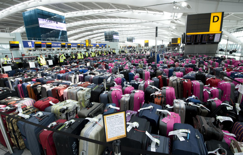 FILE - In this May 23, 2012 file photo released by British Airports Authority, over 2,400 pieces of baggage are seen lined-up in Terminal 5 at Heathrow Airport during a baggage handling exercise to prepare staff at London's main airport for the forthcoming Olympic and Paralympic games, in London. Officials at Heathrow are well aware that losing or breaking the bags of high-profile athletes could be a public relations disaster - and have geared up to ensure that doesn't happen. Heathrow has recruited 1,000 Olympic volunteers clad in bright pink to help and created special teams to deal with oversize items like javelins and bikes. (AP Photo/BAA, File) NO MAGS