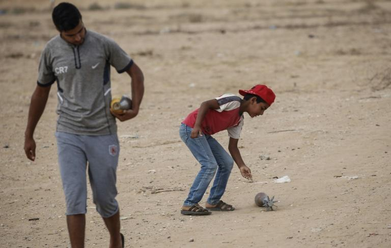 Israel has warned the Gaza Strip's residents and its Hamas rulers that further attacks on Israel could incur tougher conditions for the coastal territory; Palestinian boys carry mortar shells next to a Hamas military post August 1, 2019