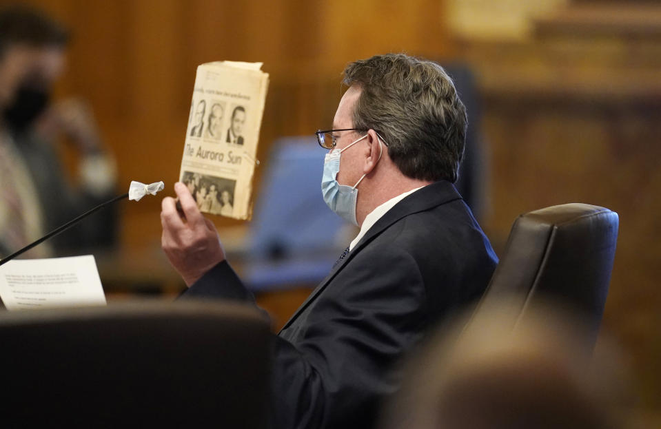 Randy Kady, 54, holds up a copy of a newspaper to illustrate to underline his testimony about the child sexual abuse accountability act during a hearing before the Senate Judiciary Committee in the State Capitol, Thursday, March 11, 2021, in Denver. Kady was sexually assaulted by a teacher in his youth. (AP Photo/David Zalubowski)