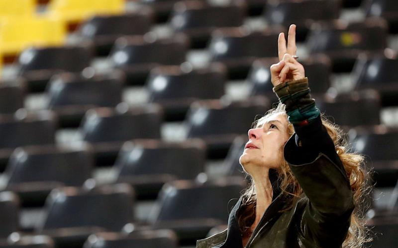 A supporter of Borussia Dortmund reacts at the stadium in Dortmund - Credit: EPA