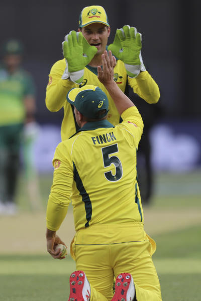 Australia's Aaron Finch celebrates with wicketkeeper Alex Carey after he caught South Africa's South Africa's Heinrich Klaasen during their one-day international cricket match in Perth, Sunday, Nov. 4, 2018. (AP Photo/Trevor Collens)