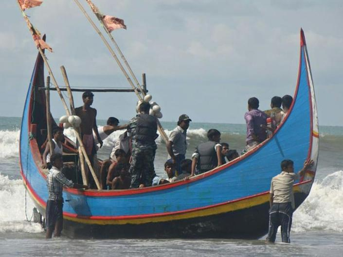 Rickety boats packed with refugees frequently run into trouble while trying to reach Malaysia and need rescuing by fishermen or Bangladeshi border guards (AFP Photo/STRINGER)