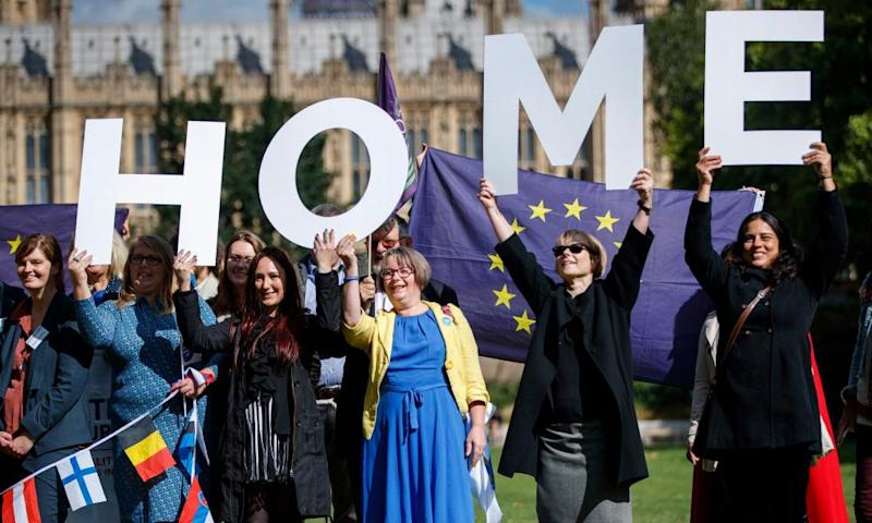 Demonstrators hold banners during a protest to Lobby MPs to guarantee the rights of EU citizens living in the UK.