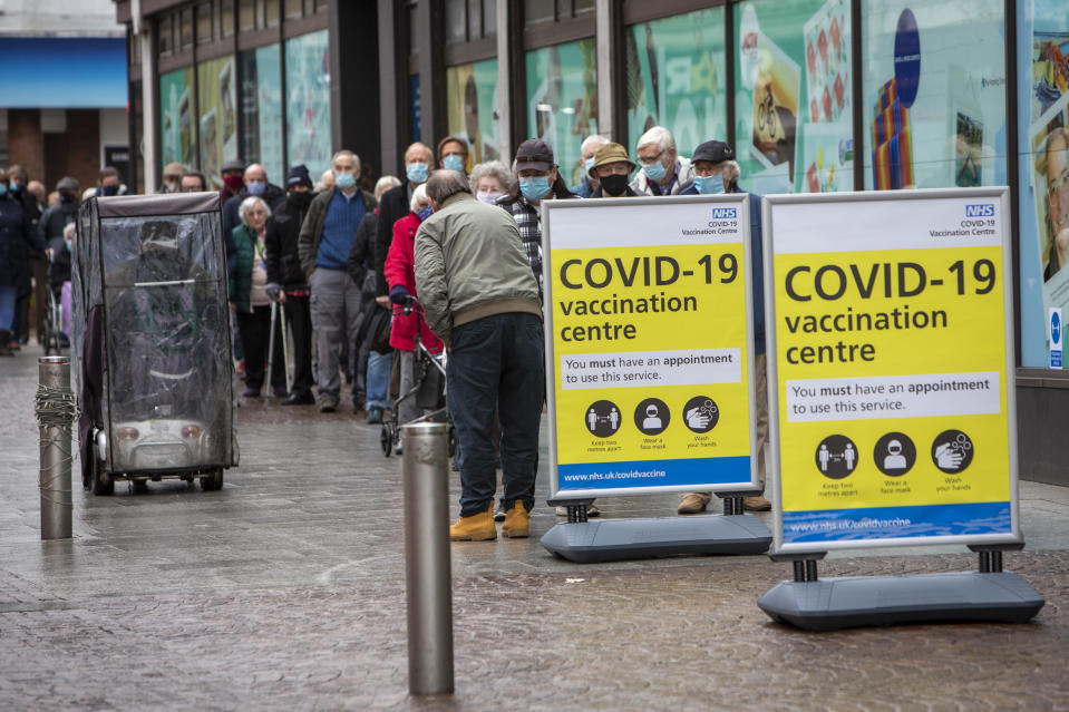 Elderly residents of Folkestone and the surrounding area line up to receive their first vaccine against COVID-19 outside the converted Debenhams store mass vaccination centre in the town centre on the 27th of January 2021 in Folkestone, Kent, United Kingdom.  The centre is being run by Kent Community Health NHS Foundation Trust (KCHFT), which has enlisted an army of vaccinators and support staff to deliver the jabs. (photo by Andrew Aitchison / In pictures via Getty Images)