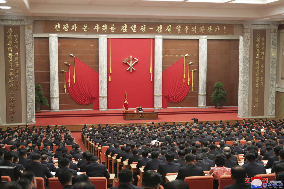 """In this photo provided by the North Korean government, North Korean leader Kim Jong Un, center, attends the ruling party congress in Pyongyang, North Korean, Sunday, Jan. 10, 2021. Kim was given a new title, """"general secretary"""" of the ruling Workers' Party, formerly held by his late father and grandfather, state media reported Monday, Jan. 11, in what appears to a symbolic move aimed at bolstering his authority amid growing economic challenges. Independent journalists were not given access to cover the event depicted in this image distributed by the North Korean government. The content of this image is as provided and cannot be independently verified. Korean language watermark on image as provided by source reads: """"KCNA"""" which is the abbreviation for Korean Central News Agency. (Korean Central News Agency/Korea News Service via AP)"""
