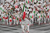 <p>Italy wore white ensembles — complete with an Italian flag on the belly — and red sneakers. Some athletes wore green, red and white scarves in their hair, too.</p>