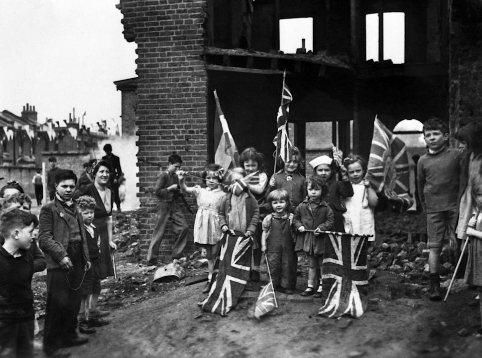 Young London residents celebrate VE-Day, (Victory-in-Europe Day) marking the end of the war in Europe, amidst the ruins of their home in Battersea.