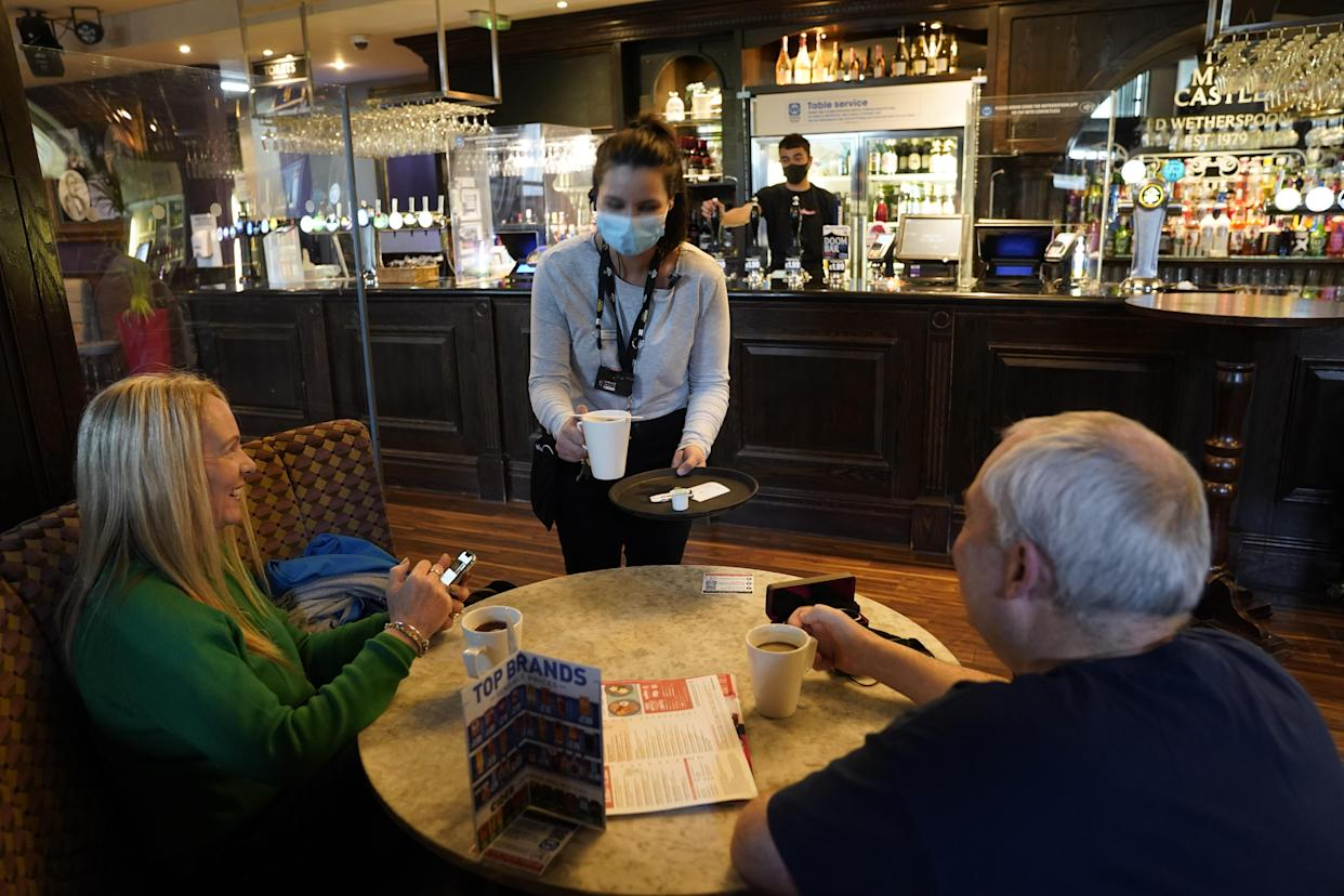 Customers inside the Mile Castle pub in Newcastle, as indoor hospitality and entertainment venues reopen to the public following the further easing of lockdown restrictions in England. Picture date: Monday May 17, 2021.