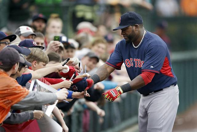 Boston Red Sox designated hitter David Ortiz signs autographs before a spring exhibition baseball game against the Baltimore Orioles in Sarasota, Fla., Monday, March 24, 2014. (AP Photo/Carlos Osorio)