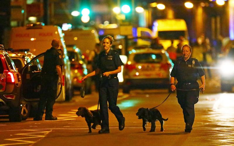 Police officers attend to the scene after a vehicle collided with pedestrians in Finsbury Park - REUTERS