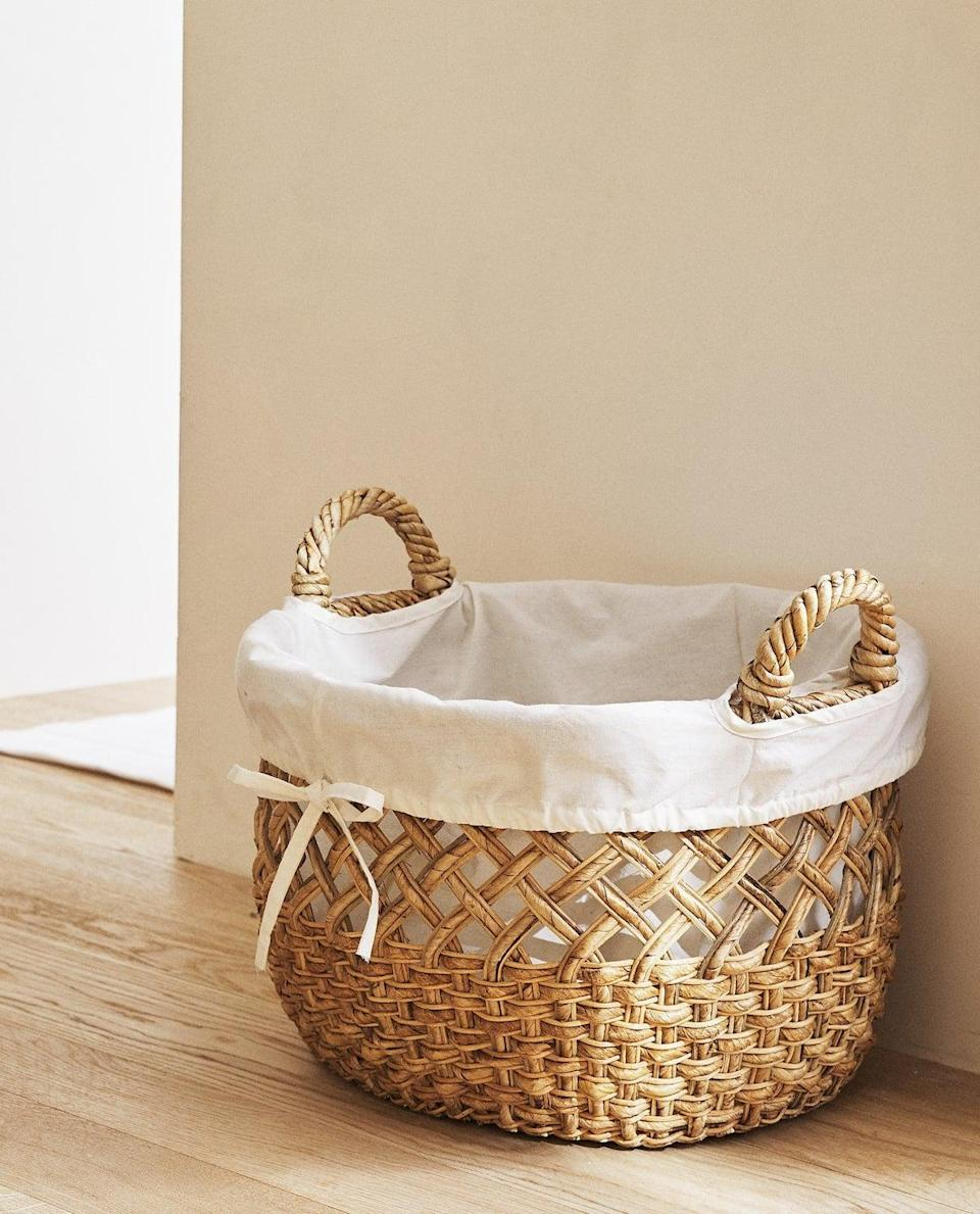 """<br><br><strong>Zara Home</strong> Oval Rattan Basket, $, available at <a href=""""https://www.zarahome.com/gb/oval-rattan-basket-l42581049?categoryId=0&colorId=700&srch=true"""" rel=""""nofollow noopener"""" target=""""_blank"""" data-ylk=""""slk:Zara Home"""" class=""""link rapid-noclick-resp"""">Zara Home</a>"""