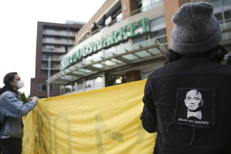 An image of Amazon founder and CEO Jeff Bezos is pictured on a jacket as people rally rally outside a Whole Foods Market in solidarity with Amazon workers in Bessemer, Alabama, who hope to unionize, in Seattle, Washington on March 26, 2021