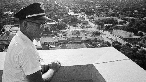 PHOTO: Sgt. Robert W. Turner, 50, of the University of Texas police, looks at the spot on the observation tower of the administration building where Charles J. Whitman was gunned down by police in Austin, Aug. 1, 1966. (AP Photo)