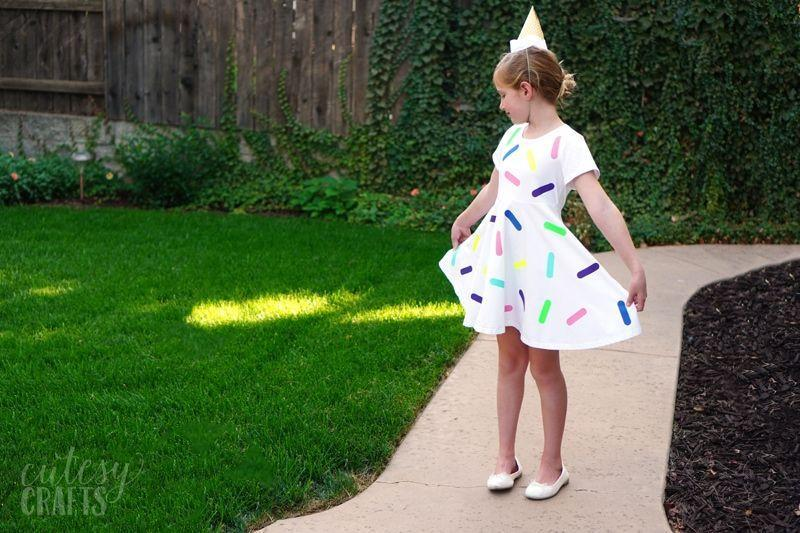 """<p>Whether you call them jimmies or sprinkles, you'll scream for ice cream with this quick and easy <a href=""""https://cutesycrafts.com/2020/10/last-minute-halloween-costume-ice-cream.html"""" rel=""""nofollow noopener"""" target=""""_blank"""" data-ylk=""""slk:DIY"""" class=""""link rapid-noclick-resp"""">DIY</a><a href=""""https://cutesycrafts.com/2020/10/last-minute-halloween-costume-ice-cream.html"""" rel=""""nofollow noopener"""" target=""""_blank"""" data-ylk=""""slk:costume"""" class=""""link rapid-noclick-resp""""> costume</a>. Complete the look<br>with a cute sugar cone topper.<br></p>"""