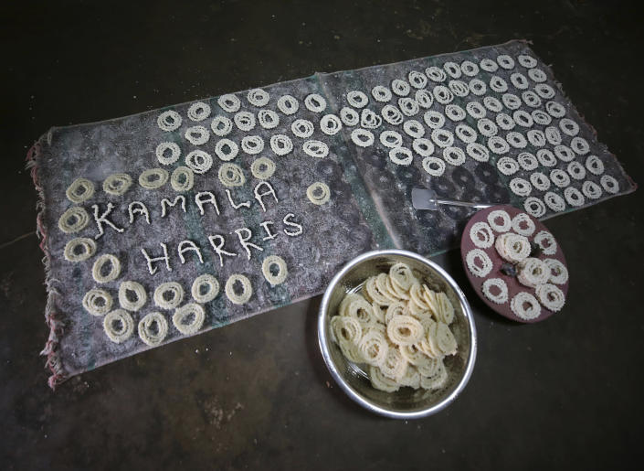 The name of U.S. Vice President-elect Kamala Harris is made from ingredients of a local savory Murukku at a village house, in Thulasendrapuram, the hometown of Harris' maternal grandfather, south of Chennai, Tamil Nadu state, India, Wednesday, Jan. 20, 2021. A tiny village in a remote part of South India is gearing up for celebrations ahead of Kamala Harris' inauguration as the first female vice president of the United States. (AP Photo/Aijaz Rahi)