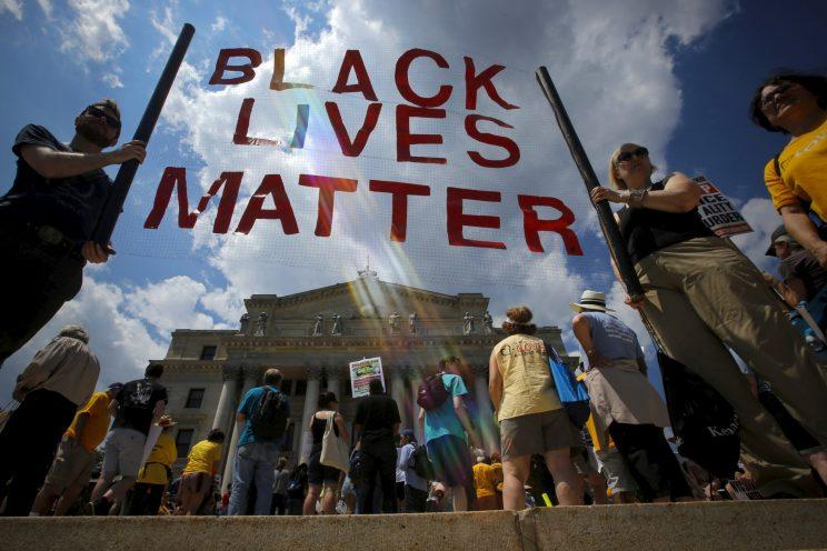 People take part in the Million People's March Against Police Brutality, Racial Injustice and Economic Inequality in Newark, New Jersey, July 25, 2015.