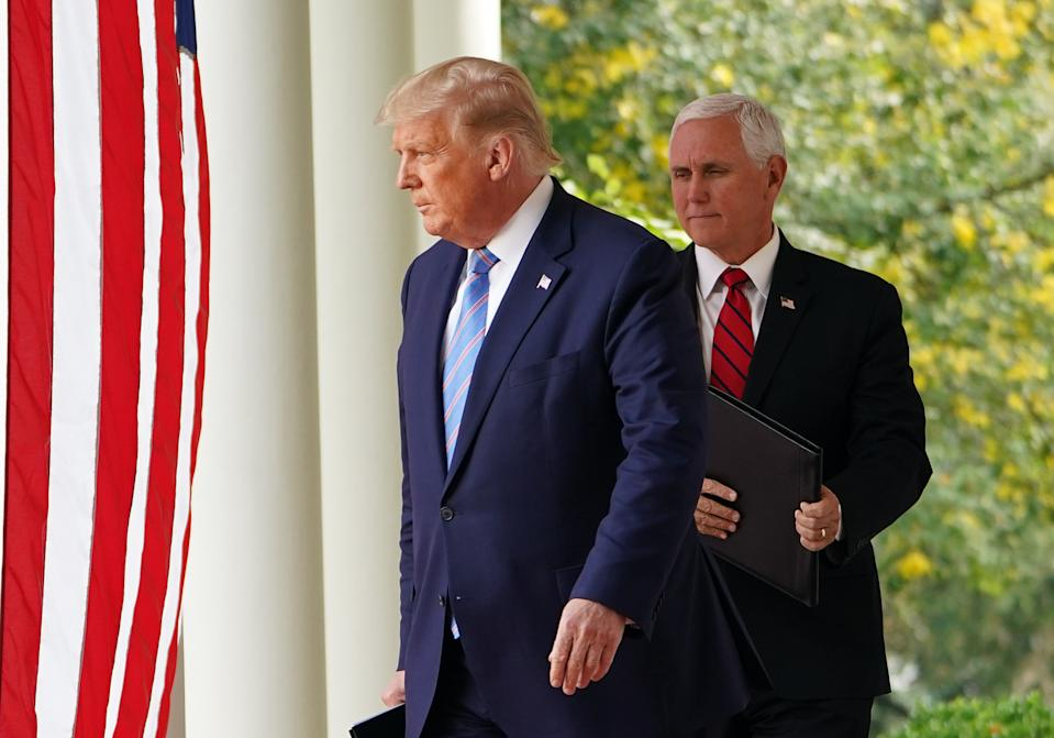 President Trump and Vice President Mike Pence next to an American flag and columns outside the White House