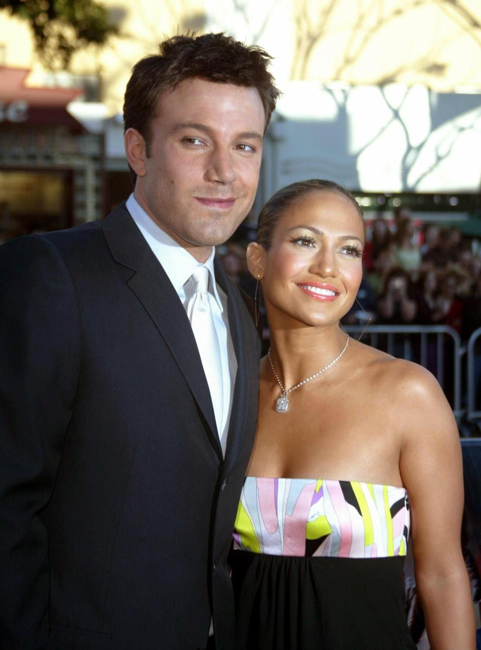 """Jennifer Lopez and Ben Affleck arrive on Feb. 9, 2003, for the premiere of the film """"Daredevil"""" at the Mann Village Theater in Los Angeles. - Credit: Hubert Boesl/picture-alliance/dpa/AP Images"""