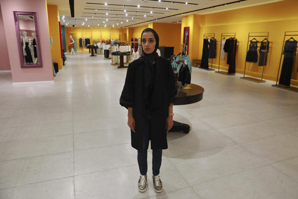 """Nasrin Hassani, a 34-year-old dressmaker, poses for a photo in a women's clothing store at Tehran Mall shopping center, in Tehran, Iran, Wednesday, June 9, 2021. Iranians this week are preparing to vote in — or perhaps boycott — a presidential election that many fear will only underscore their powerlessness to shape the country's fate. """"We have reached a point now that we wish we could return to where we were five and six years ago ... even if we can't have things improved,"""" lamented Hassani. (AP Photo/Vahid Salemi)"""