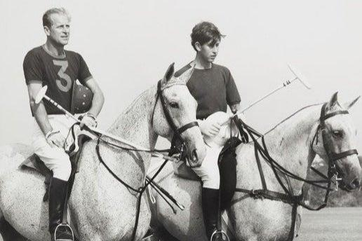 Prince Philip playing polo with his son the Prince of Wales in 1966PA