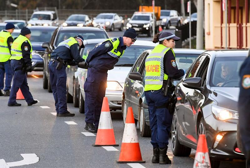 Police in the southern NSW border city of Albury check cars crossing the state border from Victoria.