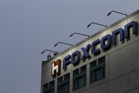 FILE PHOTO: The logo of Foxconn, the trading name of Hon Hai Precision Industry, is seen on top of the company's headquarters in New Taipei City, Taiwan