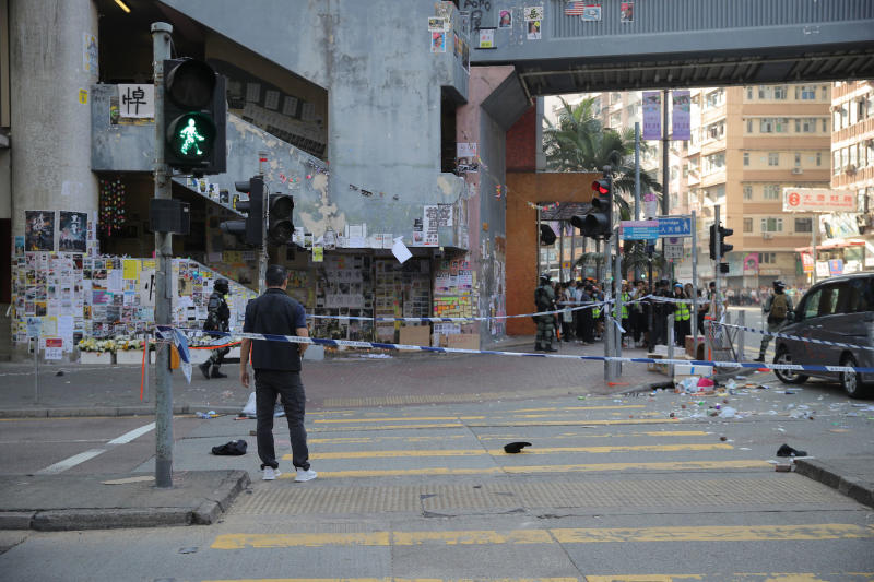 Police cordons off the scene of a morning shooting in Hong Kong on Monday, Nov. 11, 2019. Police in Hong Kong were filmed shooting at least one protester and possibly a second on Monday as demonstrators blocked subway lines and roads during the morning commute. (AP Photo/Kin Cheung)
