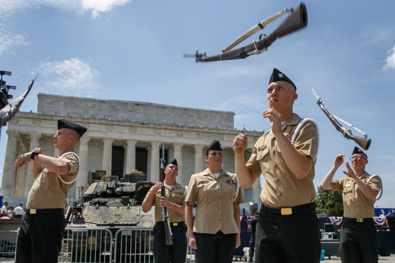 Navy Aviation Electronics Technician (AT3) Samuel McIntire, front right, and other members of the US Navy Ceremonial Guard rehearse by a Bradley Fighting Vehicle, in front of the Lincoln Memorial, Wednesday, July 3, 2019, in Washington, ahead of planned Fourth of July festivities with President Donald Trump. (AP Photo/Jacquelyn Martin)