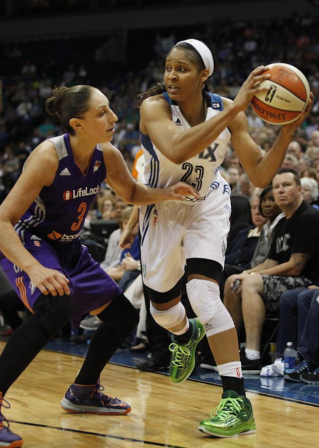Minnesota Lynx forward Maya Moore (23) looks to pass against Phoenix Mercury guard Diana Taurasi (3) during Game 1 of the WNBA basketball playoffs Western Conference finals on Thursday, Sept. 26, 2013, in Minneapolis. (AP Photo/Stacy Bengs)