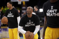 Los Angeles Lakers' Kobe Bryant, center, warms up before an NBA basketball game against the Sacramento Kings in Los Angeles, Dec. 9, 2014. (AP Photo/Jae C. Hong)