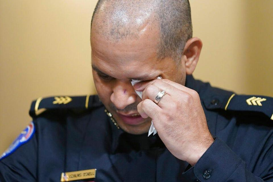 U.S. Capitol Police Sgt. Aquilino Gonell wipes his eyes as he testifies during the House select committee hearing on the Jan. 6 attack on Capitol Hill in Washington, on July 27, 2021.